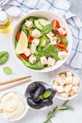 Vegan healthy salad with paprika tofu, hummus and olives