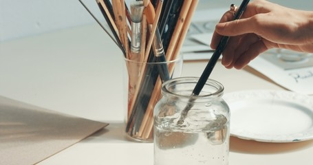 closeup of art tools in studio Paints, brushes, canvas, pencil