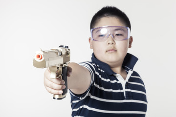A fat boy hand hold a toy gun with glasses isolated white.