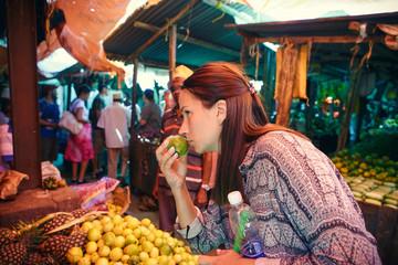 Poster Zanzibar Young woman chooses fruits at local African market