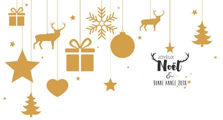 Carte de Noël avec boules dorées suspendues