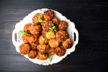 Fried meatballs served on a plate