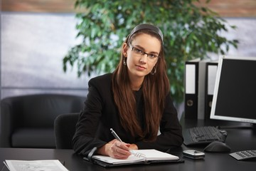 Portrait of young businesswomen at her office desk