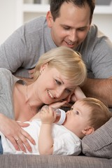 Happy caucasian family with little baby