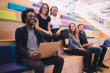 Group of mixed race team of employees in office