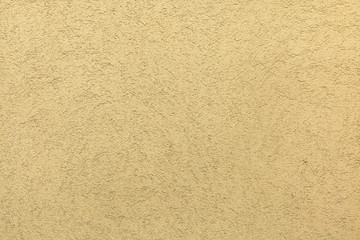 Yellow painted stucco wall. Background texture