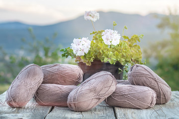 Skeins Clews Balls Wool Cotton Yarn Knitting Crochet Gentle Creamy Coffee Colored Tones. Natural Cozy Winter Fabric Texture Background Old Wooden Table Sunset Mountains