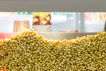 Transparent showcase filled with popcorn. Background.