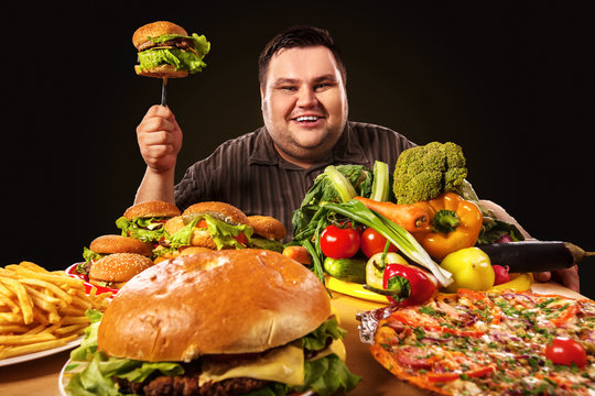 Diet fat man who makes choice between healthy and unhealthy food. Overweight male with hamburgers, french fries. Use of semi-finished products.
