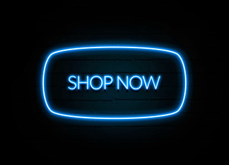 Shop Now  - colorful Neon Sign on brickwall