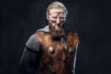 A man Viking dressed in Nordic armor.