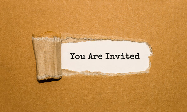 The text You Are Invited appearing behind torn brown paper