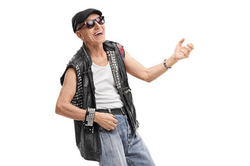 Old punk rocker playing air guitar
