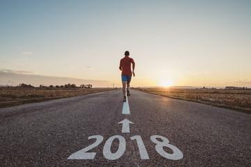 Man running to new year 2018