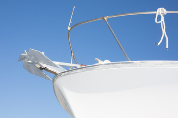 the front of a modern boat, hull and anchor