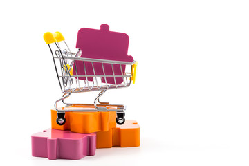Cart with puzzles on a white background.