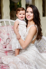 Mom and child in amazing dresses outdoor