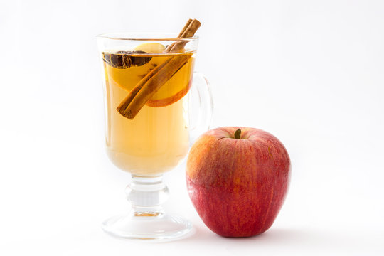 Mulled cider in glass isolated on white background