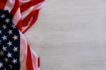 national flag of USA. Natural light. Selective focus. Close up on a gray background. Top view, flat lay. copy space.