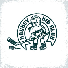 Children's retro emblem for the hockey club. Boy in uniform and helmet with stick and puck. Worn texture on  separate layer and can be easily disabled.
