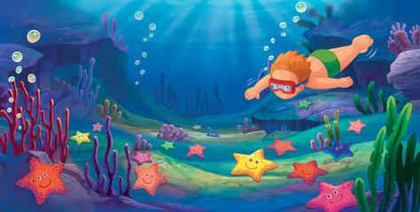 Little boy snorkeling in the sea