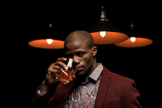african american man drinking whiskey