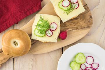 Fresh mini bagel sandwich with swiss cheese.