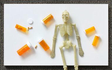 Halloween human skeleton with drugs and pills