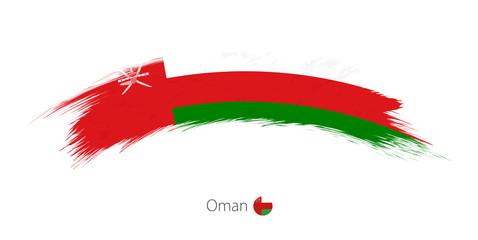 Flag of Oman in rounded grunge brush stroke.