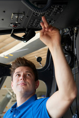Male Aero Engineer Working In Helicopter Cockpit