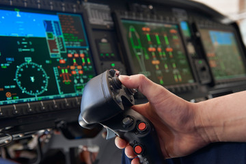 Close Up Pilot Holding Joystick In Helicopter Cockpit
