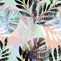 Seamless tropical pattern.Palm leaves on a colorful background.