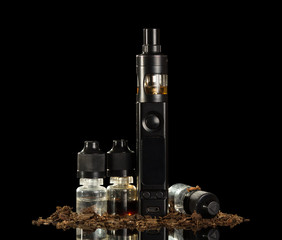 Electronic cigarette, set of liquids for inhaling steam, close-up of tobacco, isolated on black