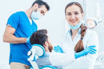 Portrait of a confident female dentist looking at camera in the dental office of a modern clinic