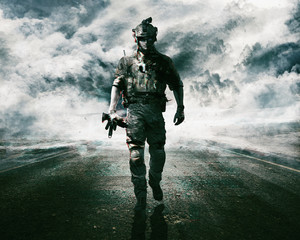 Army soldier moving towards camera on cloudscape background