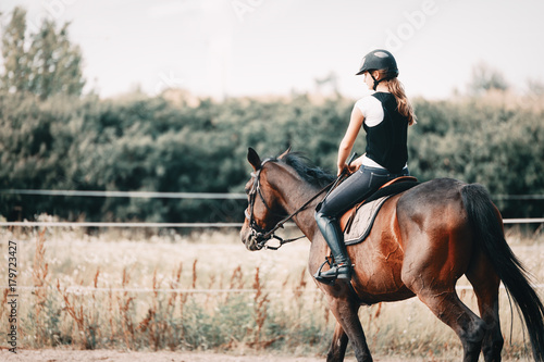 Picture of young girl riding her horse