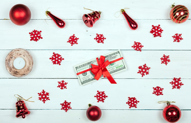 A Gift for Cristmas - a bundle of money tied with a red ribbon
