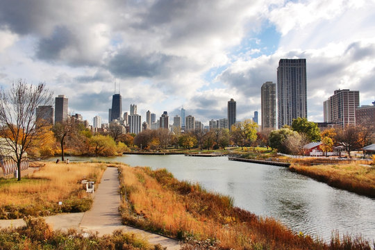 Urban cityscape and modern architecture background.Chicago downtown skyline from Lincoln Park Neighborhood located at the Lincoln Park Zoo. Autumn cityscape with cloudy sky over skyscrapers.