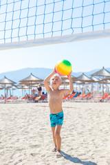 Boy playing Beach Volleyball
