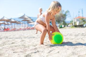 Little girl playing Beach Volleyball