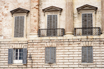 Gubbio, Perugia, Italy -  Piazza Grande, in Gubbio, architectural details of the ancient palaces