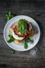 roasted tomato with mozzarella on toasted bread top view