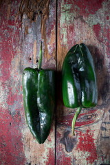 poblano peppers on rustic wood top view