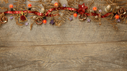 Christmas golden decoration on wooden background, close-up.