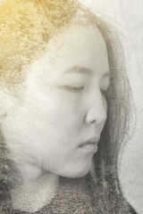Portrait of an asian young woman with the effect of double exposure, nature style.