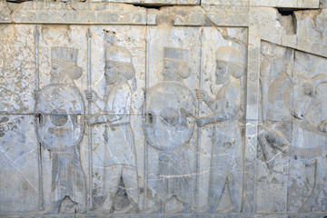 Persian warriors armed, bas relief in Xerxes palace, Persepolis, Iran.