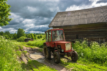 Wheeled tractor on a country road.