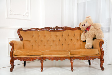 a sofa and a teddy bear
