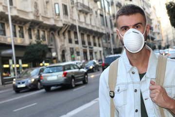 Man wearing face mask due to disgusting odor