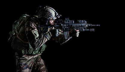 Paratrooper of french 1st Marine Infantry Parachute Regiment RPIMA studio shot firing pointing weapons